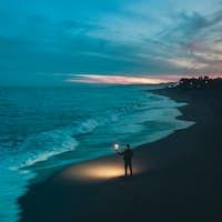 Boy looks into infinity. Look beyond the horizon