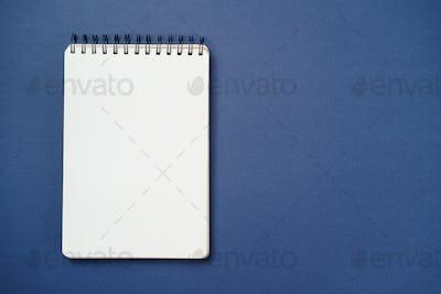 Spiral notebook on a blue background