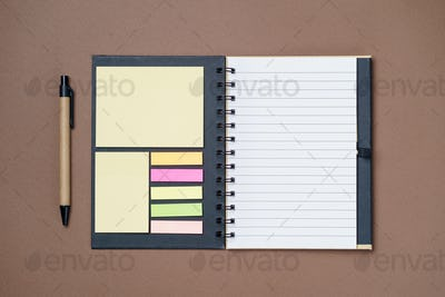 Spiral notebook on a brown background