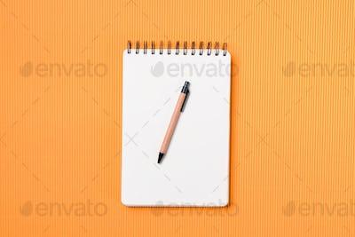 Spiral notebook on a orange background