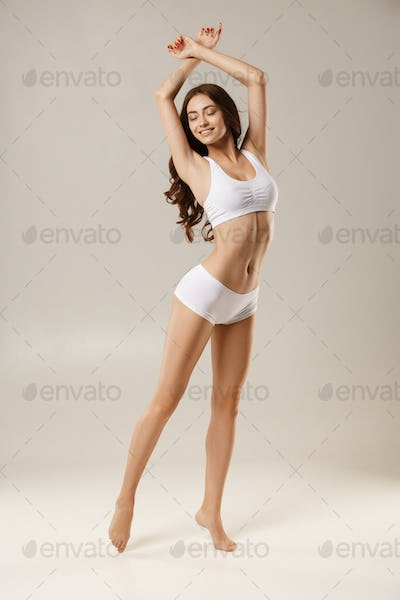 Woman with natural slim tanned body in underwear
