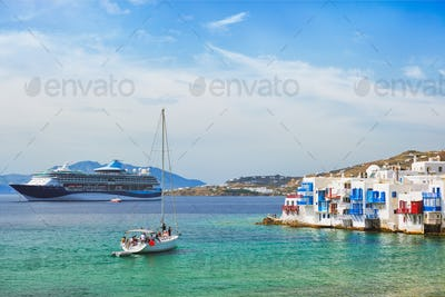 Little Venice houses in Chora Mykonos town with yacht and cruise ship. Mykonos island, Greecer