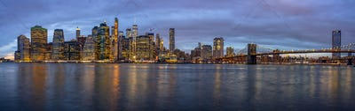 Panorama scene of New york Cityscape with Brooklyn Bridge beside the east river