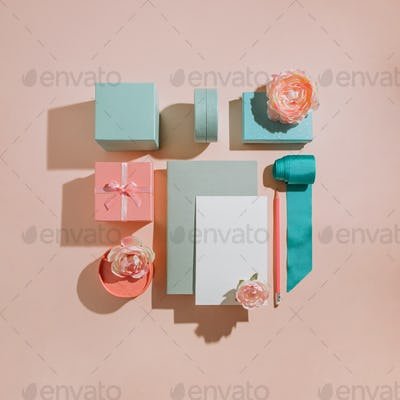 Geometric composition of gift boxes, flowers, mockup cards, invitations in pastel muted colors
