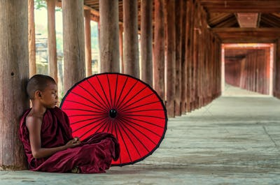 Young Buddhist novice sitting in pagoda,myanmar