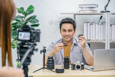 Asian Vlogger man satisfied the camera lens each media, Video Cameraman taking video