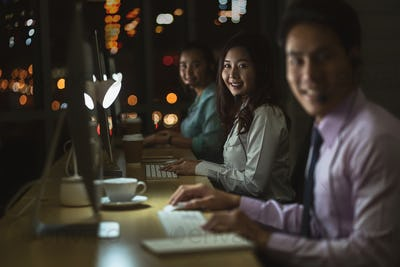 Portrait of Asian Male customer care service with businesswoman smiling and working hard late