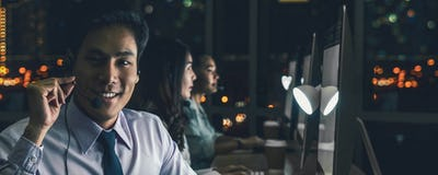 Banner of Asian Male customer care service with businesswoman smiling and working hard late