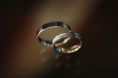 Close-up of two gold wedding rings for a wedding