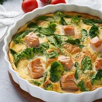 Egg-based frittata, omelette with salmon, broccoli and spinach, ketogenic healthy diet