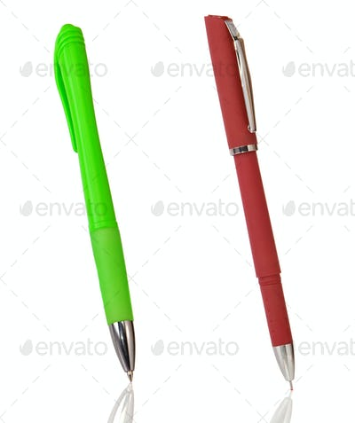 red and green pens isolated on white