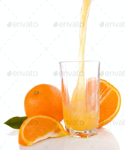 flowing juice and orange isolated on white