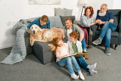 big family with dog spending time together at home