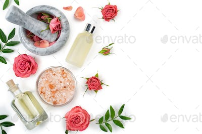 rose cosmetics concept of mortar and pestle with rose buds with dropper salt and oil