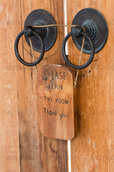 Wooden plate with sign Please clean the room