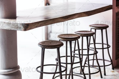 Bar with wooden vintage round tall chairs