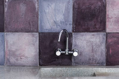 Kitchen faucet with trend stone background and marble sink