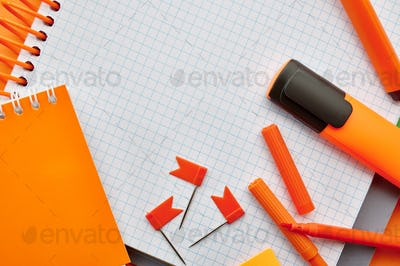 Stationery supplies, opened notepad, top view