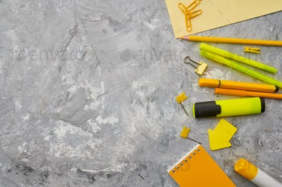 Office stationery supplies in yellow tones closeup