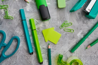 Office stationery supplies in green tones