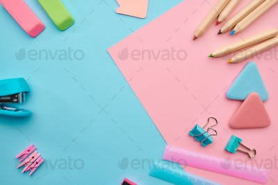Stationery supplies, blue and pink background