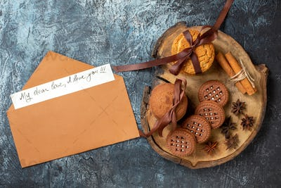 top view cookies and biscuits anises cinnamon sticks on wood board my dear love i love you written