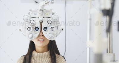 Woman doing eye test in clinic
