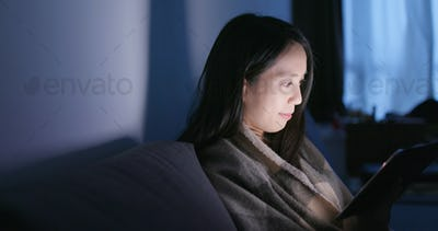Woman use of smart phone on bed at home
