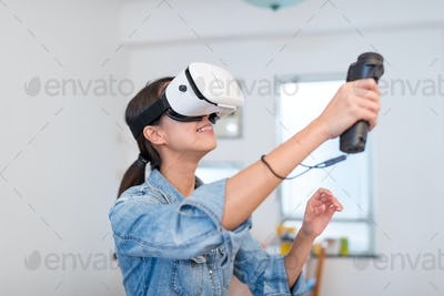 Woman playing game with virtual reality