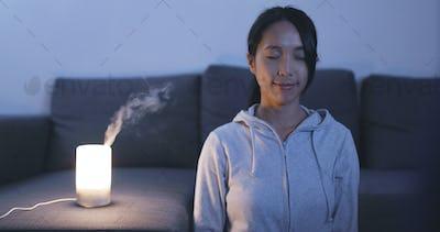 Woman having meditation at home