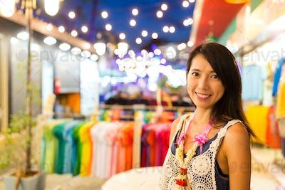 Woman in night street market