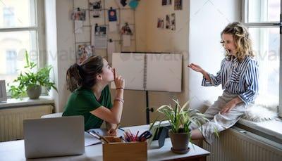 Teenager schoolgirl learning online indoors at home, coronavirus and disturbance concept.