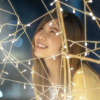 Closeup Portrait of asian woman with light at night, merry christmas and new year celebration