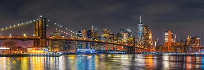 Panorama scene of New york Cityscape with Brooklyn Bridge over the east river at the twilight time