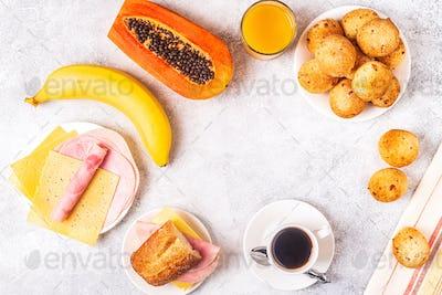 Traditional Brazilian breakfast - cheese bread, coffee, ripe fruit.
