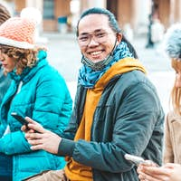 Multiracial friends using mobile phone tracking Coronavirus spread