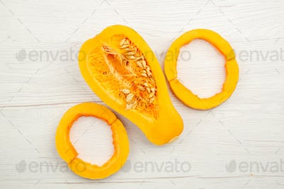 top view circle shaped butternut squash slices half squash on grey wooden table free space