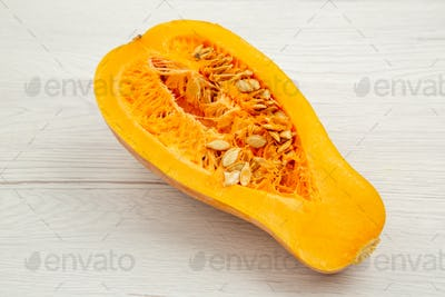 bottom view butternut squash cut in half on white wooden background free space