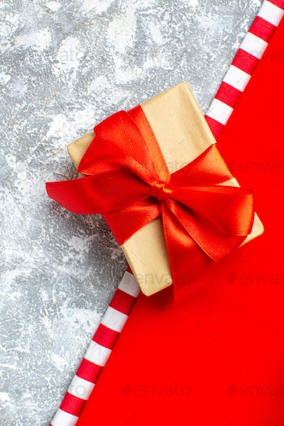 top view xmas gift tied with red ribbon on grey white background with copy space