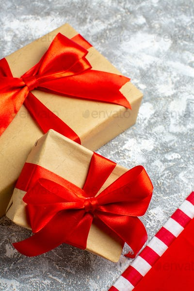 bottom view xmas gifts with red ribbon on grey background