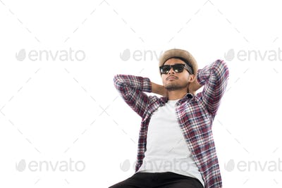Portrait of young hipster man with hat on isolated over white studio background.