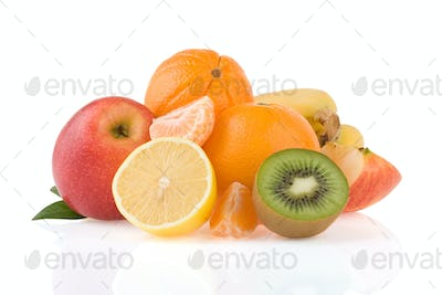 fresh tropical fruits and slices isolated on white