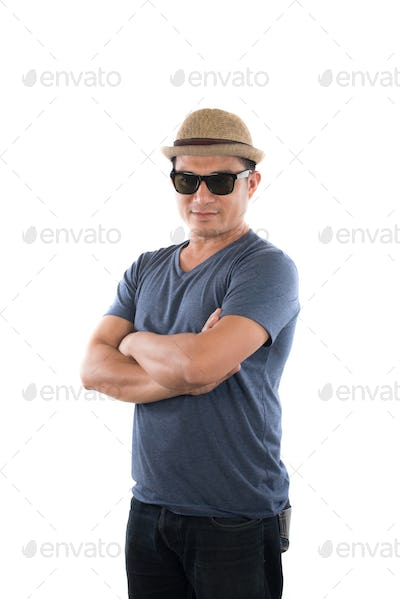 Young man wearing blue t-shirt hat with head at camera on isolated over white studio background.