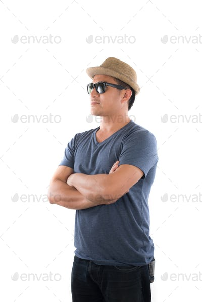 Portrait of young hipster man wearing blue t-shirt hat with head at camera on isolated over studio.