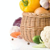 healthy vegetable food and basket isolated on white