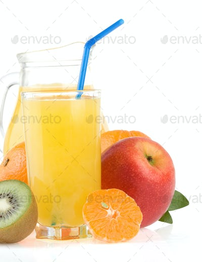 fresh tropical fruits and juice in glass isolated on white