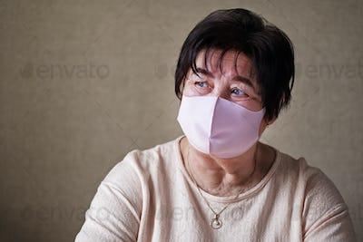 Masked grandma sad
