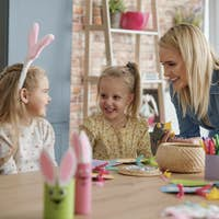Mum and two daughters have fun making Easter decorations