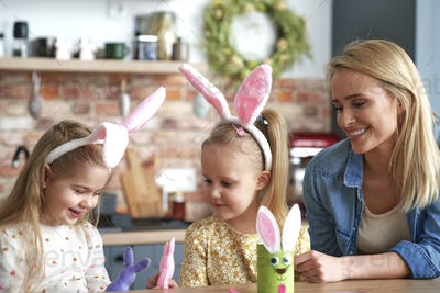 Happy mom with daughters during Easter time