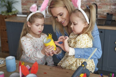Mather and two daughter preparing Easter yellow chicken